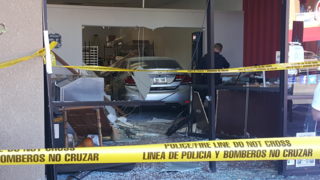 Driver crashes into popcorn store on eastside