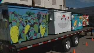 City reveals mural-painted dumpsters