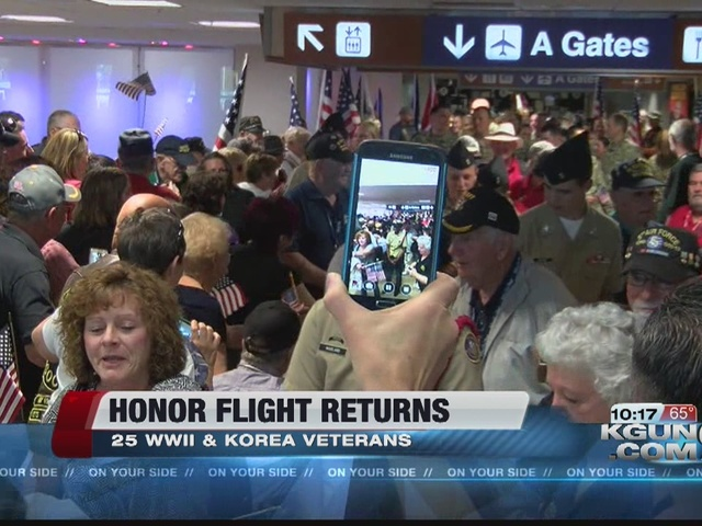 Ww ii and korean war vets return from honor flight kgun9 com