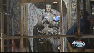 Grant helps restore statue at San Xavier