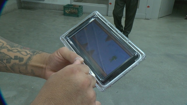 Inmates using tablets at the Pima County Jail