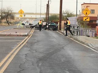 Part of 12th Ave closed after car goes into pole