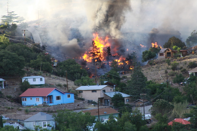 Firefighters mopping up fire in Bisbee; 4 structures burned