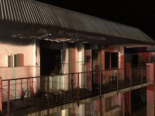Woman hospitalized after apartment fire