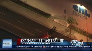 Car crashes through two gates during chase