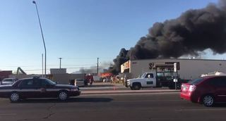 Fire burning at scrap yard on Tucson's southside