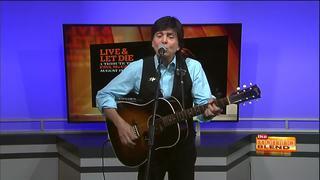 Tony Kishman performs