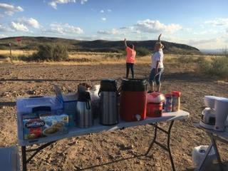 Two women serving coffee to drivers near Safford