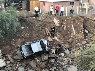 Man dies after vehicle swept away by floodwaters