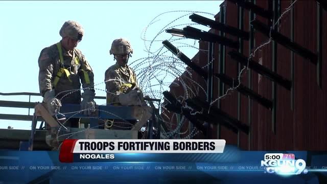Soldiers take on fortifying border- awaiting migrant caravan