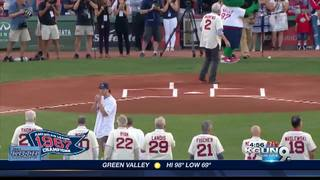 UA alum takes brunt of wild first pitch