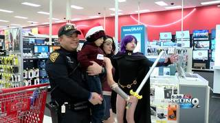 Police officers take kids shopping for toys