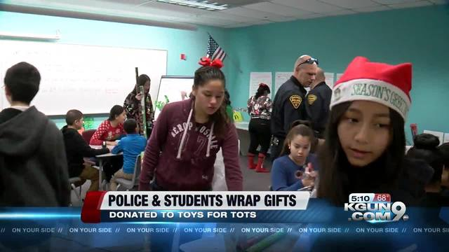 Police Toys For Tots 2017 : Police and students wrap gifts for toys tots kgun