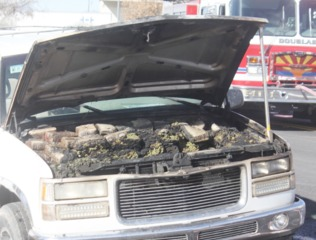 Marijuana in hood of car that caught fire