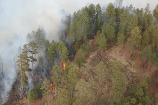 Cooler temps to come as crews fight wildfire