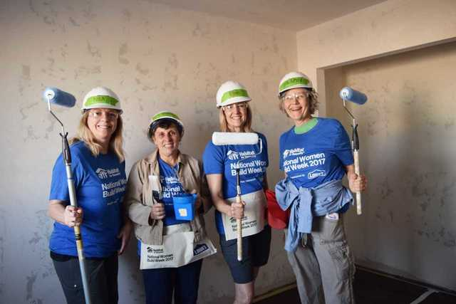 Women show off their strength to help build home for local family
