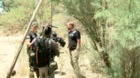Navy Seal Team examines abandoned camp of I-19