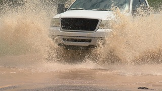 Storms cause running washes and flooded roads