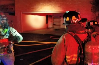 Firefighters contain flames to portion of home